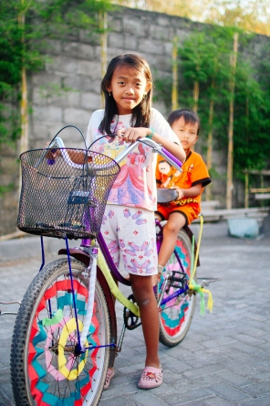 """Why do you have streamers on your bike?"" ""It makes it a happy bike"". (Yogyakarta, Java)"