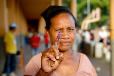 A woman holds up her stained finger after voting in 2012 in Timor-Leste's presidential run-off poll. Photo credit: Bernardino Soares, UN Photo