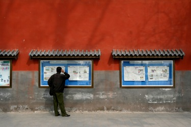 Feature image: Noliv Orange, Reading the newspaper at Bei-Hai park in Beijing